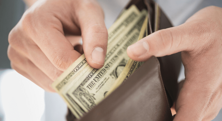 open wallet and man's hand counting cash