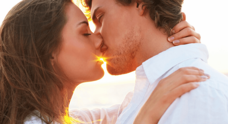couple kissing each other with their eyes closed